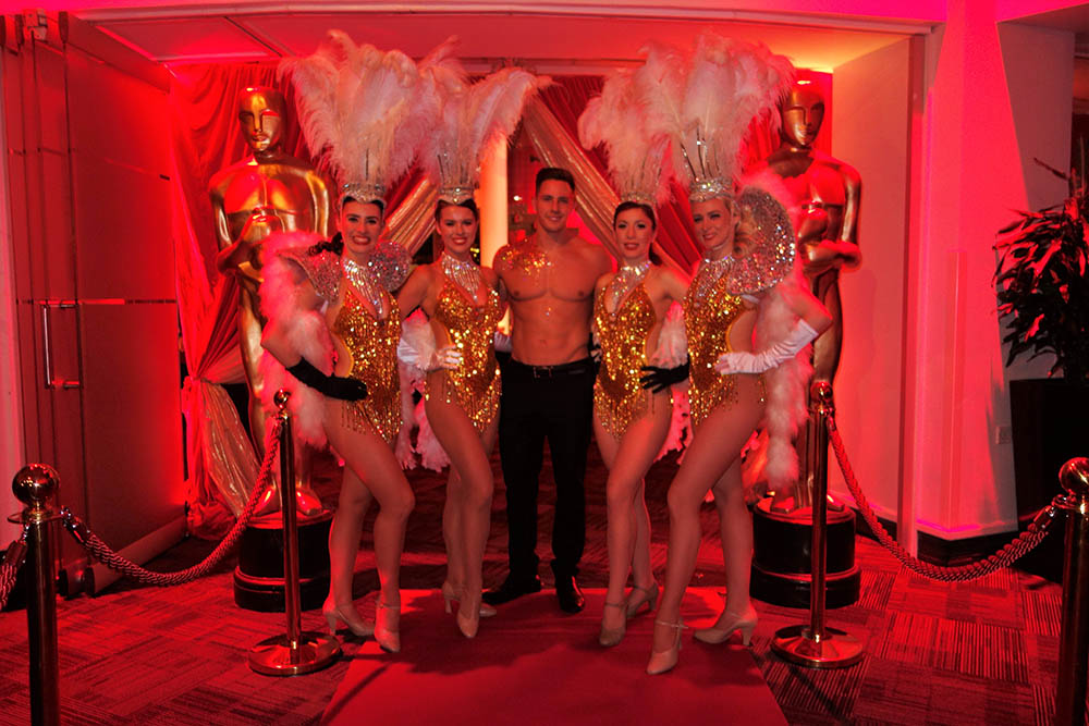 Gold and white showgirls performers
