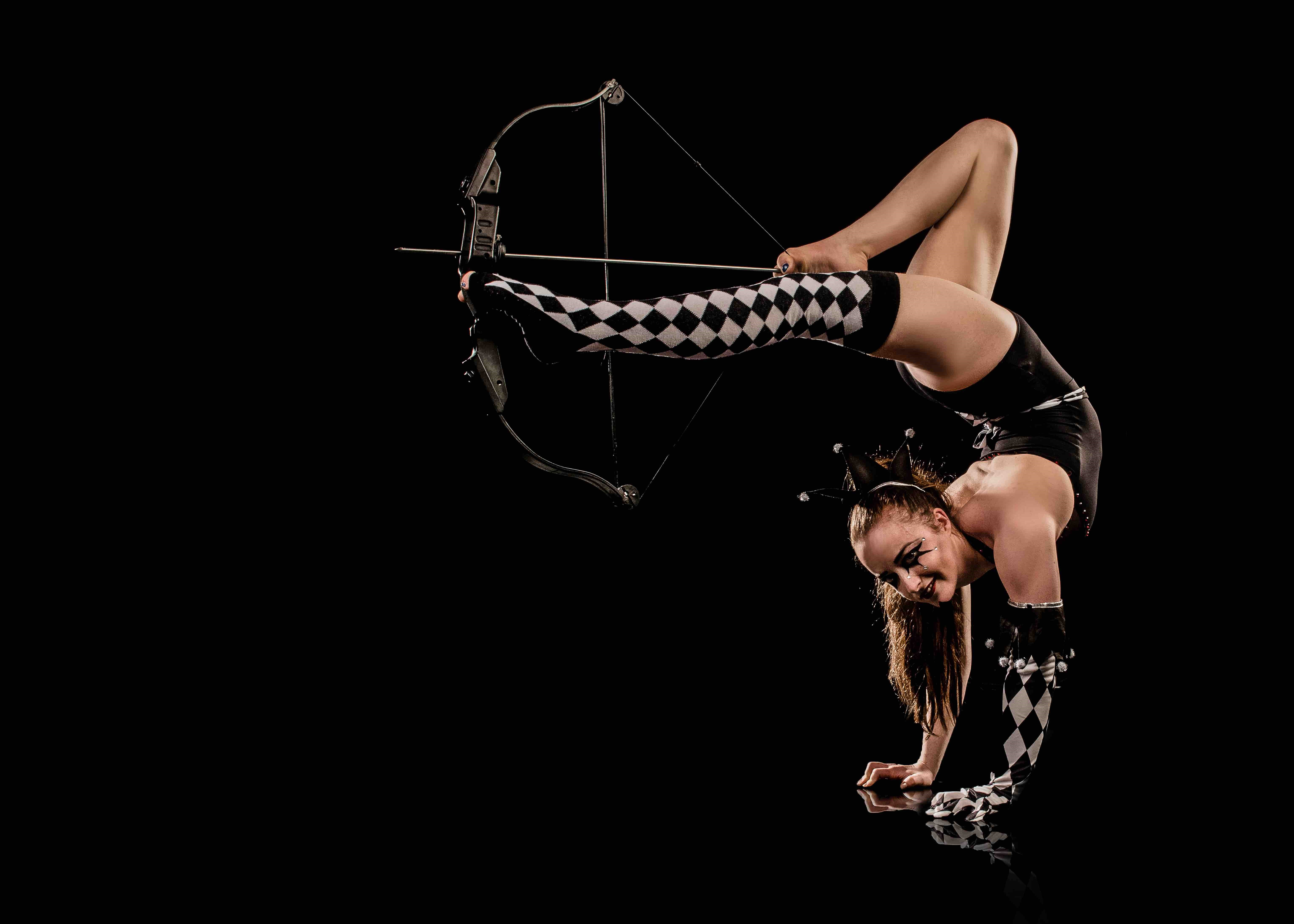 bow and arrow performer
