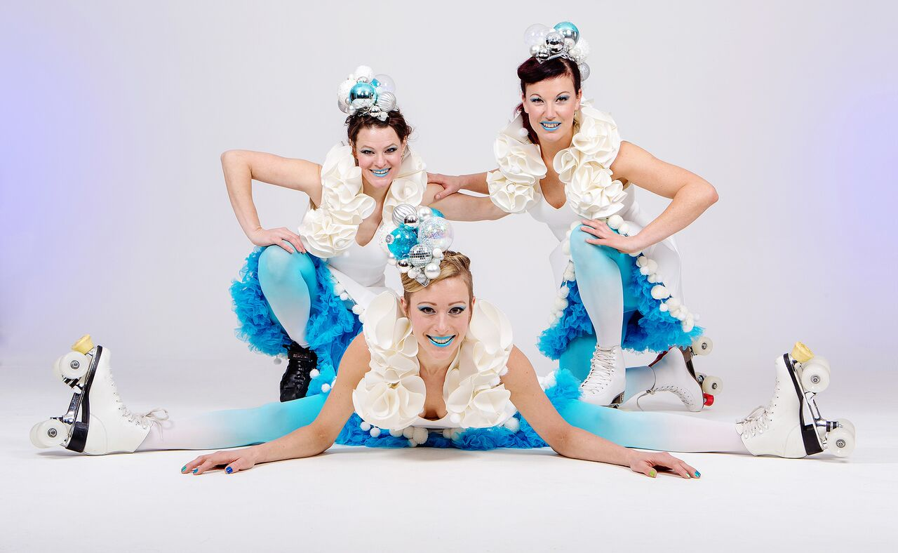 Winter themed roller skating performers