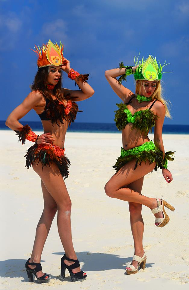 carnival stilt walkabout rio beach feathers dance