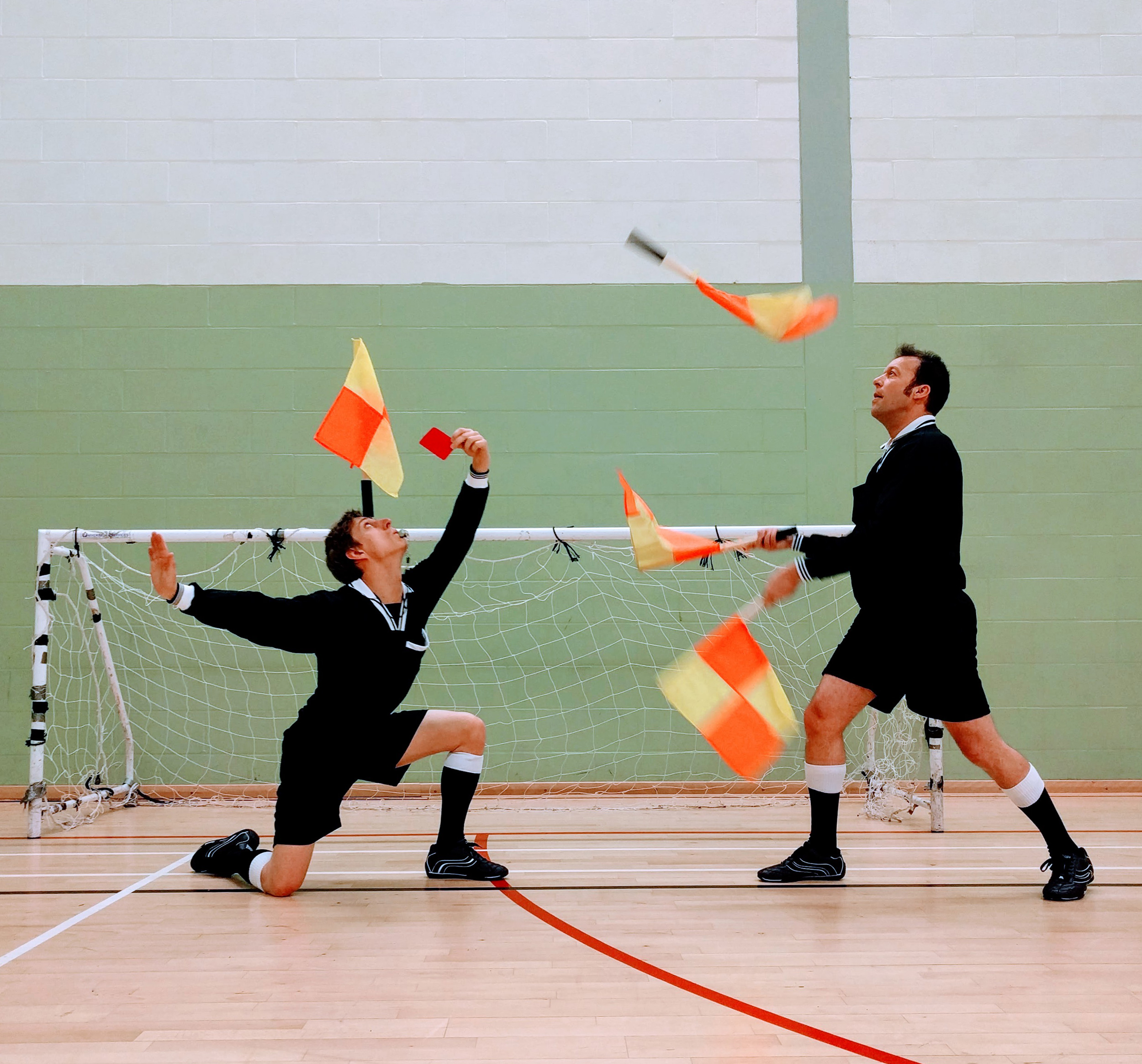 referee circus entertainment juggling sport athlete football rugby tennis cricket